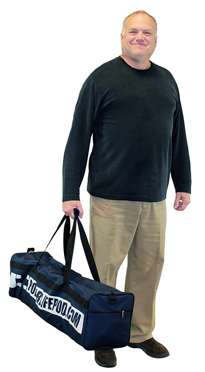 Man carrying a polar life pod gym bag